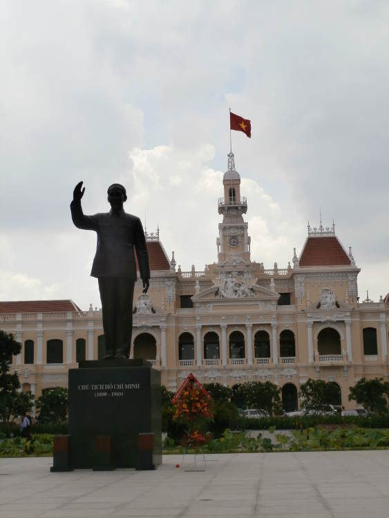 Vietnam - Ho Chi Minh City HCMC Saigon - statue of Uncle Ho Chi Minh in front of the city hall